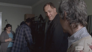 Tobin smiles at Carol, introduces himself, and offers to teach Carol to shoot, any time. Better safe than sorry.