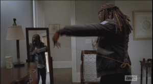 Michonne pulls out the katana and customizes one of the laces that is too long to be functional.