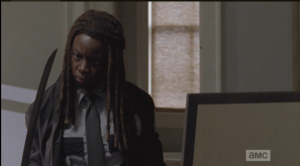 Michonne looks at the katana...she seems to be wondering,