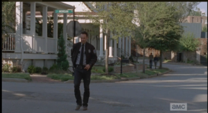 We see Rick walking past