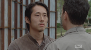 Glenn does not rise to the bait, but he doesn't back down, either. He says softly,