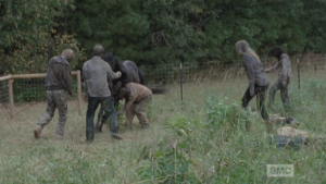 Before the men can act, the walkers surround the horse and savagely attack it as it whinnies helplessly.