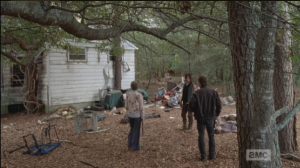 The Porch Council has convened outside the abandoned little house in the woods where Rick had stashed his handgun in the plastic blender... there is a walker nearby, but Daryl says it's only one, rejoins the council.
