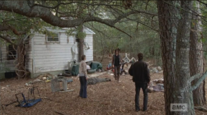 We see Rick, in his constable's uniform, Carol, in her Junior League uniform, and Daryl in his Daryl Dixon uniform, vest and greasy hair.  Brother has still not taken a shower yet...that's some willpower. I would have taken like 25 showers by now, and brushed my teeth like 100 times.