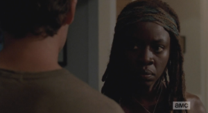 Michonne's face gets even more serious.