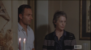 Meanwhile, Rick and Carol try to act natural at the party. They watch Olivia arrive, and that means the storeroom and armory are unguarded at the moment.  Rick once again offers to back Carol up, but once again, she tells him to stay put...Rick watches her leave, says,