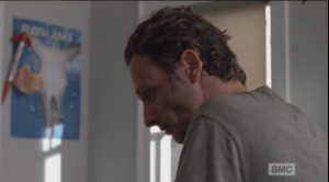 Rick sits on the edge of the bed, diplomatically says that the place