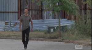 As soon as he steps out into the road, Rick starts to get freaked when he doesn't see his children around, anywhere.