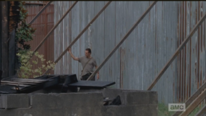 Damn, are those bracings on the outside of the fence? I thought they were on the inside...that fence may hold off walkers, but a living enemy could pull down those bracings, or use them to scramble up and over the wall. Major design flaw, Reg.