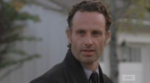 ...and we see a glimpse of our favorite madman, Rick Smash!  He no likey seeing another man's arm around his woman...