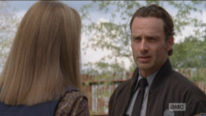 Rick brings Deanna outside, points out that the walls need to be partrolled always, not just checking for damage, but also for any activity or signs that they had been breached. Rick also points out that someone could move right up the supports on the outside of the walls.