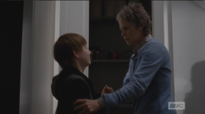 Carol pulls Sam out of the cupboard, asks him angrily what he's doing there...Sam cheerfully informs her that he didn't tell anybody about the guns. That kid sure doesn't scare easy!