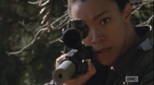 Sasha's eyes are wild, and her manner is looking more and more agitated as she raises her rifle again, and begins picking off all the framed pictures, one by one. Each shot is perfectly aimed, not a bullet wasted...