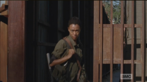 Sasha thanks the gate  keeper as she walks out of Alexandria into the world outside the gates.