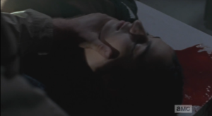 We see Tara, unconscious on a table, blood still seeping out of her head wound.