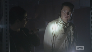 Tara then turns and shines her flashlight on Eugene, who gapes in fear and horror at the trapped walkers...