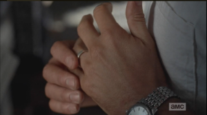 Then he reaches down and twists his wedding ring...is it time to take it off?