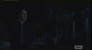 As Rick walks down the darkened, empty streets, a voice carries to him from one of the front porches.
