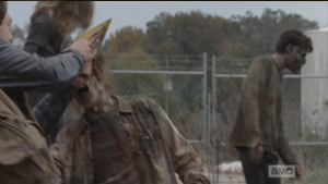 ...while Aaron uses his newfound Alaska license plate to slice through the walkers' brains, like a walker-killing MacGyver.