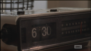 In the next scene, we see an alarm clock strike 6:30 am...
