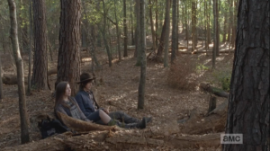 Still laughing at her walker prank, Enid and Carl find a felled tree stump and sit down to take a breather.