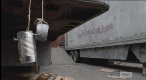 As they approach the tractor trailers, Daryl and Aaron don't seem to notice that each trailer has a couple of empty cans, with holes punched through and strung up alongside, or under, the trailers. They catch the wind, and seem to be some kind of noisemakers...