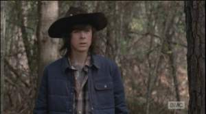 Carl peers around, looking for Enid, when he hears her voice call out,