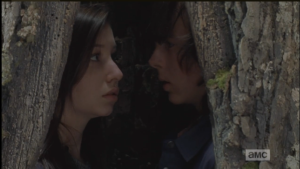 Carl and Enid turn to face one another...