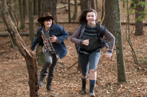 In a beautiful slow-motion sequence, set to a dreamy  Bear McCreary score, we see the young people run through the woods, happy and free.  Young love and innocence shining through, even in these dark times.