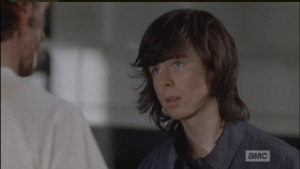Carl looks into his dad's eyes.