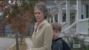 Carol looks at Rick, Sam hiding behind her, like,