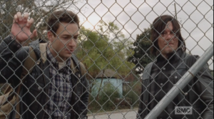As Daryl surveys the trucks through the fence, Aaron laments,