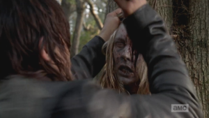 Daryl quickly does the young woman walker a solid rekill, plunging what may have been Beth's knife into her skull, ending her misery.