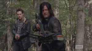 As Aaron takes this all in, Daryl lifts his crossbow and stealths forward, as he realizes,