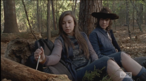Enid reaches into her pack, pulls out a fine knife with a wooden handle,  and begins carving into the stump.