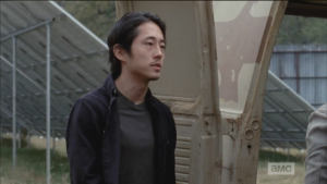 Glenn approaches, comes around the van, addresses Nicholas, who is inside.