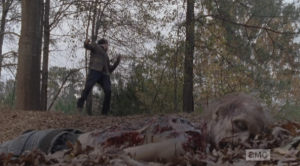 Glenn falls to the ground.