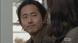 Instead of voicing his real thoughts, Glenn smiles at Maggie, tells her,