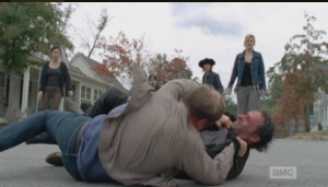 ...but the large man gains the advantage, and ends up on top of Rick.