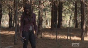 Michonne then looks down at the gun she is holding...she seems to be thinking about what the gun represents: the Alexandria way, and her new position as constable. Is their