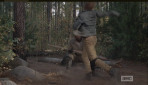 Morgan ducks low to evade another wild swing from the blond wboy's scythe, and the young man's balance is thrown off again...a swift strike from Morgan's staff into the young man's lower spine sends him toppling forward into the dirt.