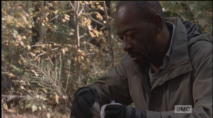 Morgan takes the cup from the fire, rips open a packet of instant soup or something, and pours the contents in the cup. As he stirs his breakfast, the shot pans out...