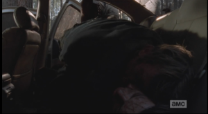 In the next shot, we see Morgan carefully lay the unconscious blond man on top of his dark haired counterpart in the back seat of the abandoned car he had spent the previous night in. Enjoy your nap, douchebags, and btw, those