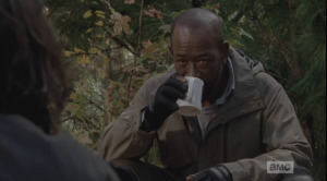 Morgan's hand pauses, the mug stops mid-sip. He lowers the mug.
