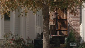 ...Nicholas, climbing up, and over, the fence. Glenn stands, looks around, then sets off after Nicholas.