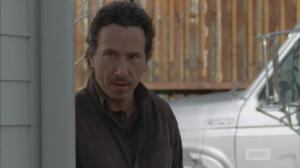 Nicholas Lurker watches Glenn, hatred in his eyes...he surely has his handgun on him.
