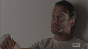 Rick looks away, turns up his hand like a shrug, then looks back at Carol.  (You said it yourself, Rick Grimes...here you are.) Locking eyes with Carol, Rick says,
