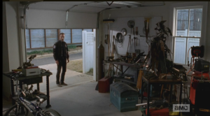 As Rick Grimes stands there, still searching for the words, the garage door begins to roll down in front of him.