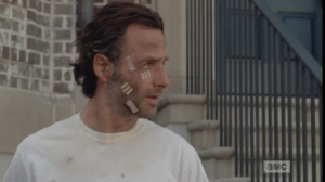 Rick steps out of juvie, blinking in the sunlight...