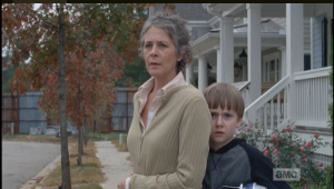 Terrified, Sam hides behind Carol. Many TWD fans speculated on Sam's choosing Carol over his own mother for comfort and protection.